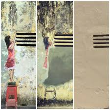 one of lithuanian artist ernest zacharevic s famous murals girl with stool and birdcage  on mural wall art ipoh with street artist accepts removal of mural in ipoh malaysia malay mail
