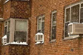 newest air conditioners. with storage space scarce, new yorkers often leave their air conditioners in windows through the winter. credit richard levine/alamy stock photo newest