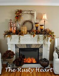 layered use of old frame gvine fall flowers on a mantel totally loving this mantle as it looks like an electric fireplace insert which is exactly