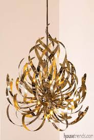 modern lighting fixtures like this chandelier help to catch the light without giving the room a stuffy formal feeling