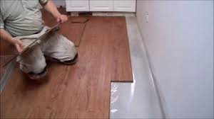 how to install laminate flooring on concrete in the kitchen mryoucandoityourself you