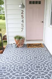 painted cement floor using a stencil to create a cement tile look