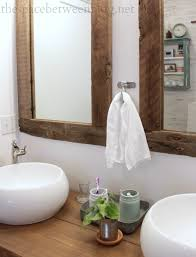 reclaimed wood framed mirrors featuring the space between