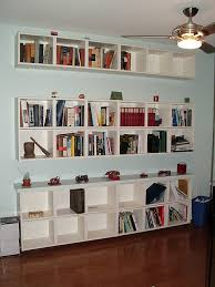 Work around for fireplace switch. Ikea Billy bookshelves, horizontal. Love  the idea of