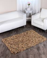 dark wood floor with mocha leather rug unique for your interior decor how to clean gy rugs grey brown woven area bath company ivory geometric