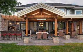 a beautiful outdoor kitchen with seating area interiordesigninspiration net