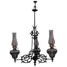 three arm cast iron chandelier model 108 still in oil circa 1868 to 1884