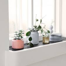 ferm living plant stand. small plant pot - light grey. ferm living stand