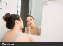 Asian Woman Holding Mirror Touching Worrying Her Face Stock Photo