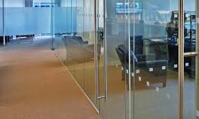 what is the code requirement for eye level safety decals to be affixed to full height glass walls