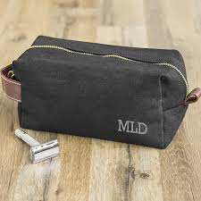 3 custom initials on lower right side of wet waxed canvas dopp bag