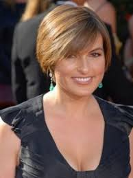 hairstyles for women over 60 rounded very short round with highlights