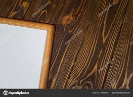 dark wooden frame with an empty picture on a wooden dark background stock image