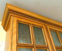 molding for kitchen cabinet doors copyright kitchen cabinet s light caramel rope glass doors and crown