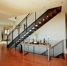 ... Contemporary with candles entry floating stairs. Image by: Rhodes  Architecture Light