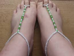 after the top portion of the sandal is complete and number of beads or length noted to make your matching pair string your beads on each strand