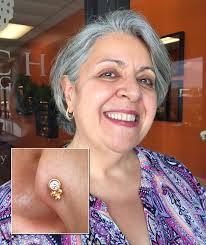 Mature woman genital piercing