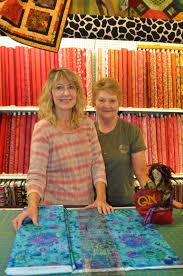 Quincie's Big Adventure: Road Trip! & Got to love a quilt shop called the Cosmic Cow. And you have to meet owner  Roxann O'Hare, left, and her mother Elaine Pieper. Adamdwight.com