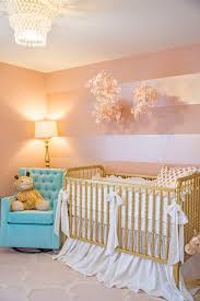nursery with white furniture. project nursery pink and gold with metallic stripes on accent wall white furniture