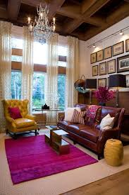 a bright pink rug is the perfect way to add color to a living room with a brown color scheme