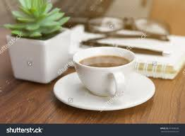 office coffee cups. A Coffee Cup On The Office Desk In Sunrise Is Happy Time. #coffee Cups S