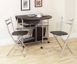 small dining room spaces with black painted color oval double drop leaf dining table with stainless steel legs and folding chairs storage ideas
