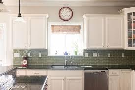 rosewood light grey raised door painted kitchen cabinet ideas backsplash subway tile glass concrete countertops sink