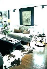 small cowhide rug living room sofa for oversized throw pillows navy blue velvet neutral fake faux