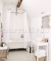 freestanding bath with shower. freestanding bath with shower curtain in bathroom of contemporary oxfordshire cottage england uk
