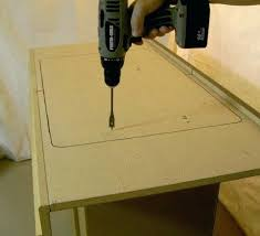 cutting sink hole in laminate countertop photo showing pilot hole being drilled for sink cut out
