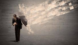 business man protecting with umbrella against wind of papers royalty free stock images