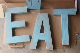 how to create distressed wood look letters in two easy steps by the everyday home