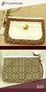 Coach monogram white leather wristlet
