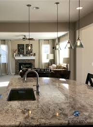 sherwin williams barcelona beige in open layout kitchen and living room granite stone fireplace