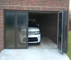 folding glass garage doors overhead folding garage bi doors door fire station glass interior basyakinfo folding glass garage doors