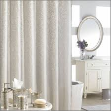These curtains with a subtle rose pattern are part of a bath collection  that also has other accessories displayed in the photo. This bath  collection will ...