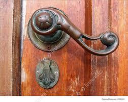 architectural details old wooden door with a decorative br door handle