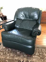green leather lounging recliner