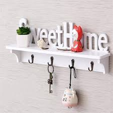 key wall holder hollow wood sweet home wall shelf with hooks white coat hat  clothes storage