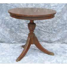small round antique table with drawer image and candle