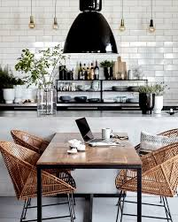 modern rattan furniture. loving the black white and rattan look of this vintage modern kitchen dining room furniture