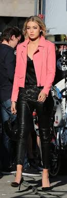 rock a neon pink leather jacket with black leather fitted pants to achieve a chic look