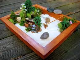 wooden mini zen garden with sand and rake