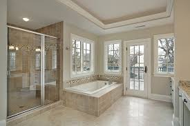 cream wall paint color combined ceramic wall textured ceramic shower wall white wood cabinets ideas