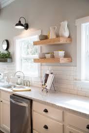 best backsplash flooring counters subway tile kitchen magnolia farms wood shelves like the tiles gooseneck lamp white cabinets and walls painted mindful
