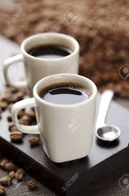 two modern espresso cups on a wooden table stock photo picture