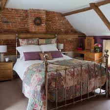 copper metal bed frame for french country bedroom with brick wall decor and fl comforter