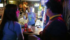 kirstie ward serves drinks to shaina riggs and luis martinez at empire bar on peoria ave just south of east 15th street june 12 2017