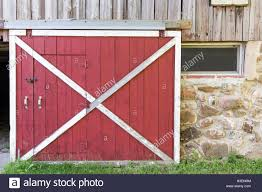 red and white barn doors. Partially Open Red Barn Door In A Weathered Barn. Traditional White Framing, Wood And Doors G