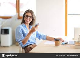 woman office furniture. Woman Office Furniture. Beautiful Young Business Sitting At Desk And Talking On Cell Furniture Tree Solutions